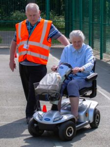 This lady had never driven a scooter before but after a short time, was enjoying showing well she could steer